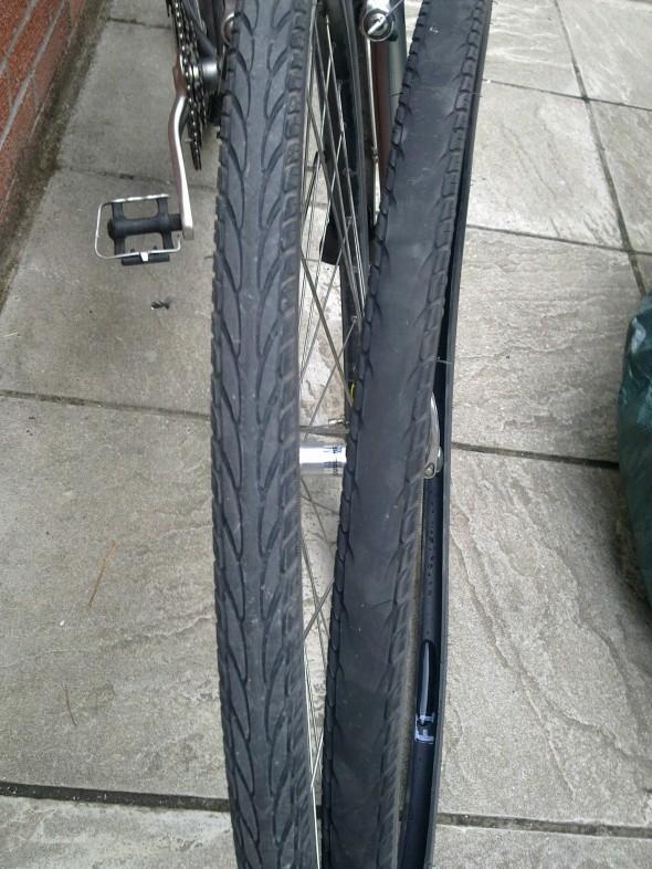 Tread from rear tyre all gone.